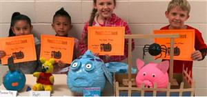 Photo of Pumpkin Contest Winners with their pumpkins
