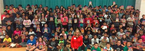 Photo of students with author Jo Watson Hackl