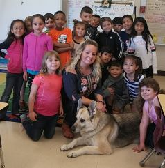 Photo of Roxy with Mrs. Johnson's Class